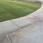 Indian sandstone paving & turf.
