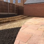 Sandstone paving, decorative aggregate, large bedding areas, sweeping curves 3.