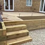 Retaining wall / steps, honed sandstone & lighting.