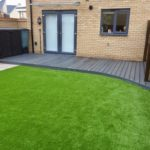 Composite deck area & artificial turf.