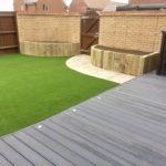 Composite deck area, artificial turf & sandstone path.