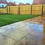 Sandstone pavers, turf & fence.