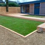 Cedar decked area / garden pod & natural turf.